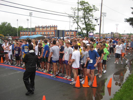 Runners straggle to the Rowley 5K start